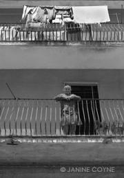 Woman-on-Her-Balcony-Janine-Coyne